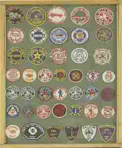 A selection of American cloth Fire Brigade badges,