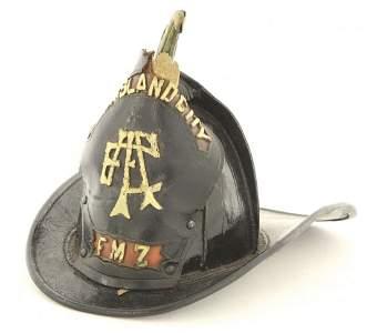 An early Long Island City fireman's helmet, black