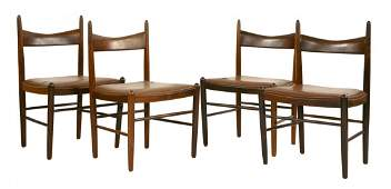 A set of four Danish rosewood dining chairs, designed