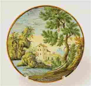 A Castelli maiolica Plate, c.1730, typically painted