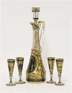 An enamelled and gilt Decanter, Stopper and four
