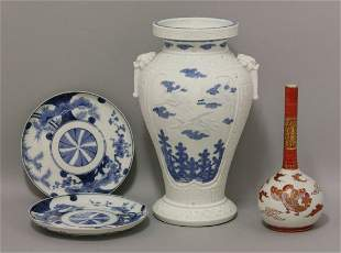 An Hirado Vase, c.1860, moulded with cranes over flying