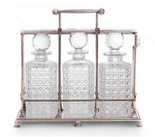 A Victorian silver-plated three bottle tantalus,by