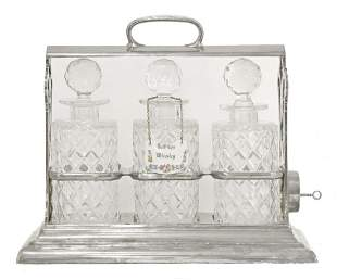 A silver-plated tantalus,by Walker & Hall, 'The Only'