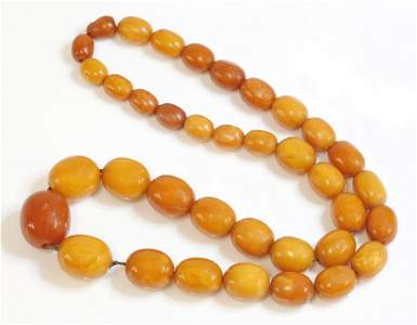 A single row graduated butterscotch amber bead