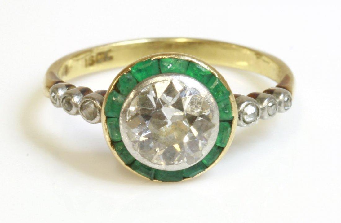 An Art Deco diamond and emerald target ring, c.1925, an