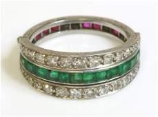 An Art Deco emerald ruby and diamond swivel guard