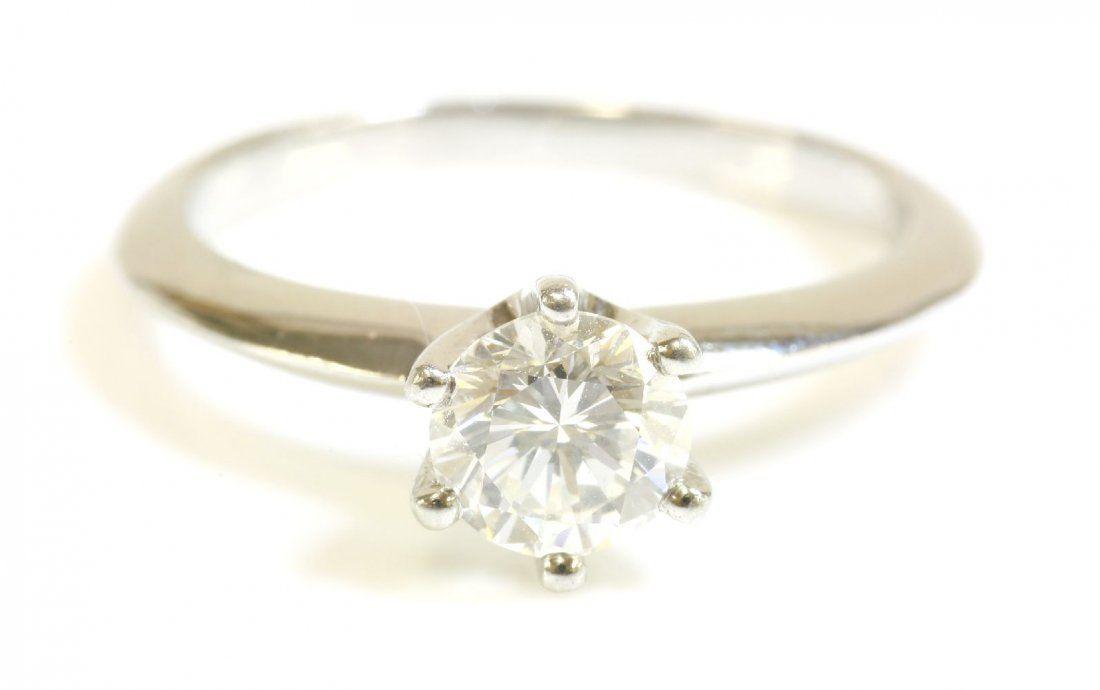 A platinum single stone diamond ring, with a brilliant