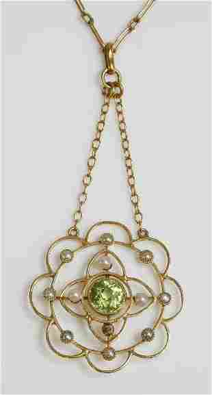 An Edwardian peridot and split pearl gold pendant, with