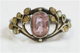 An Arts and Crafts silver, gold, pink tourmaline and