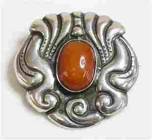 A Skonvirke Danish brooch, c.1910, with an oval