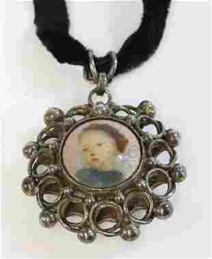 An Arts and Crafts silver enamel pendant, with a
