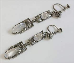 A pair of silver Arts and Crafts moonstone drop