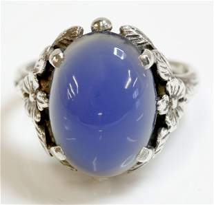 An Arts and Crafts silver single stone chalcedony ring,