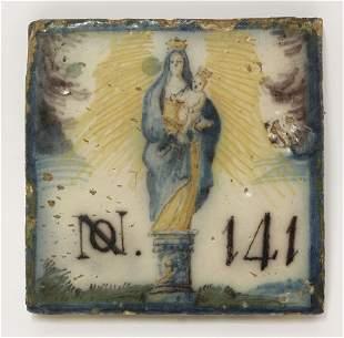 A rare Italian maiolica Tile, c.1700, painted in blue,