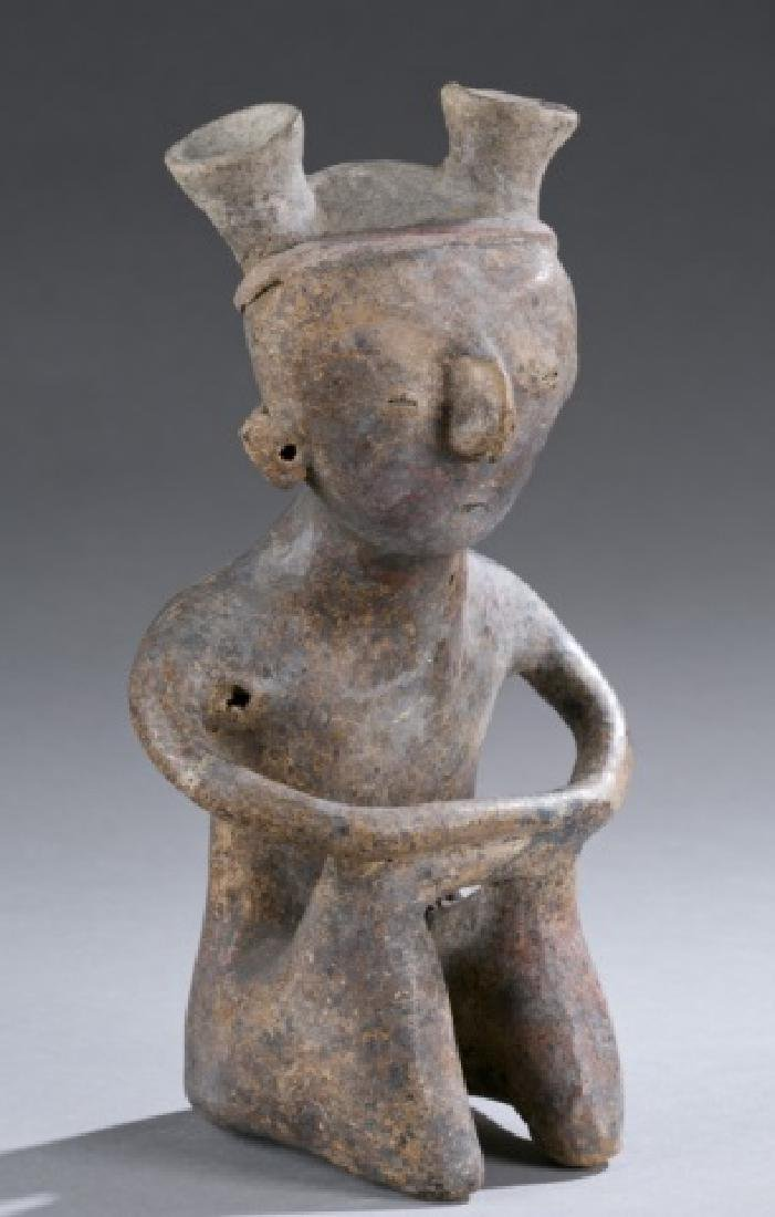 Zacatecas seated figure of man.