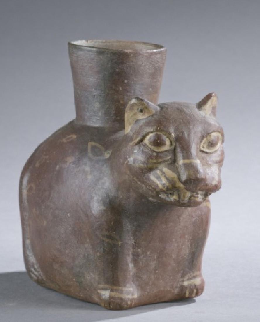 Moche jaguar pottery figure.
