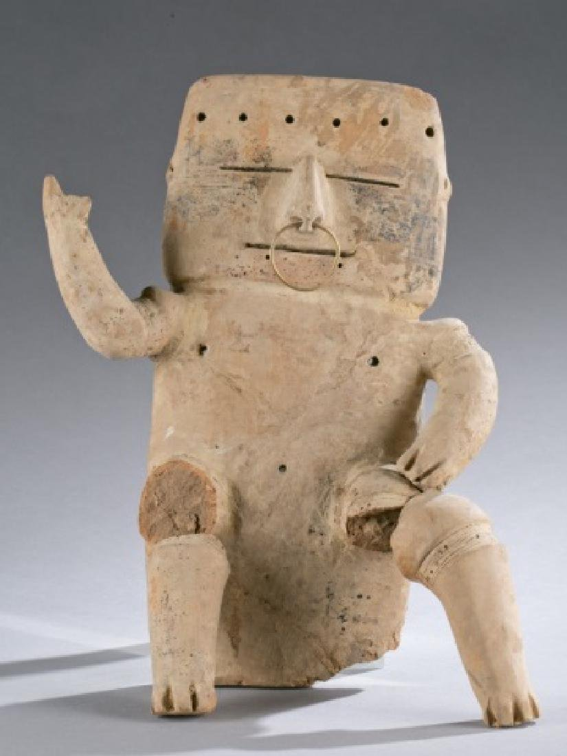 Quimbaya seated male figure.