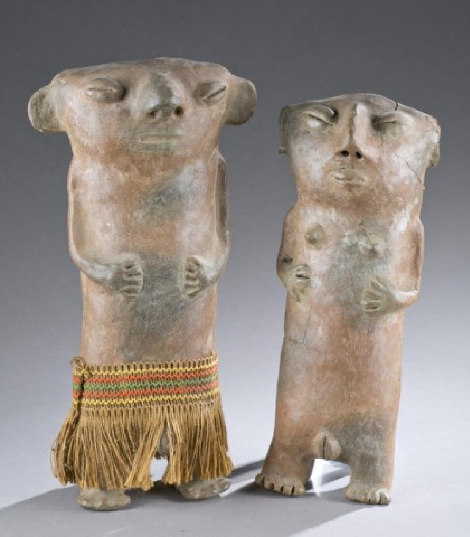Pair of standing figures.  CE 1000-1500.