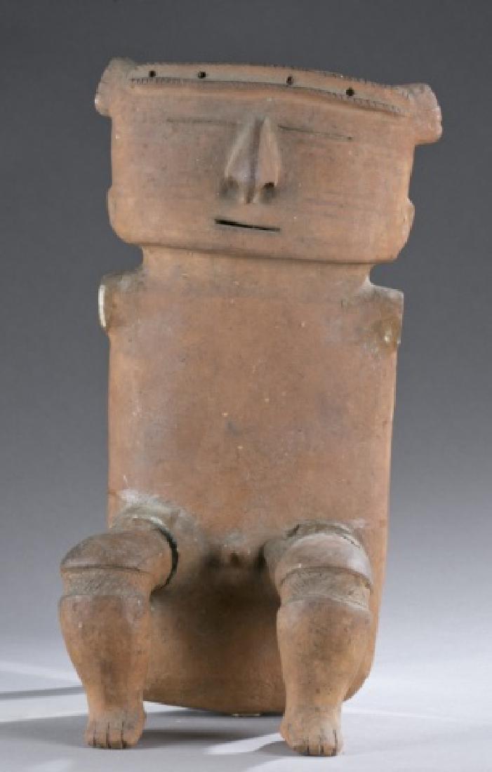 A seated Quimbaya figure.
