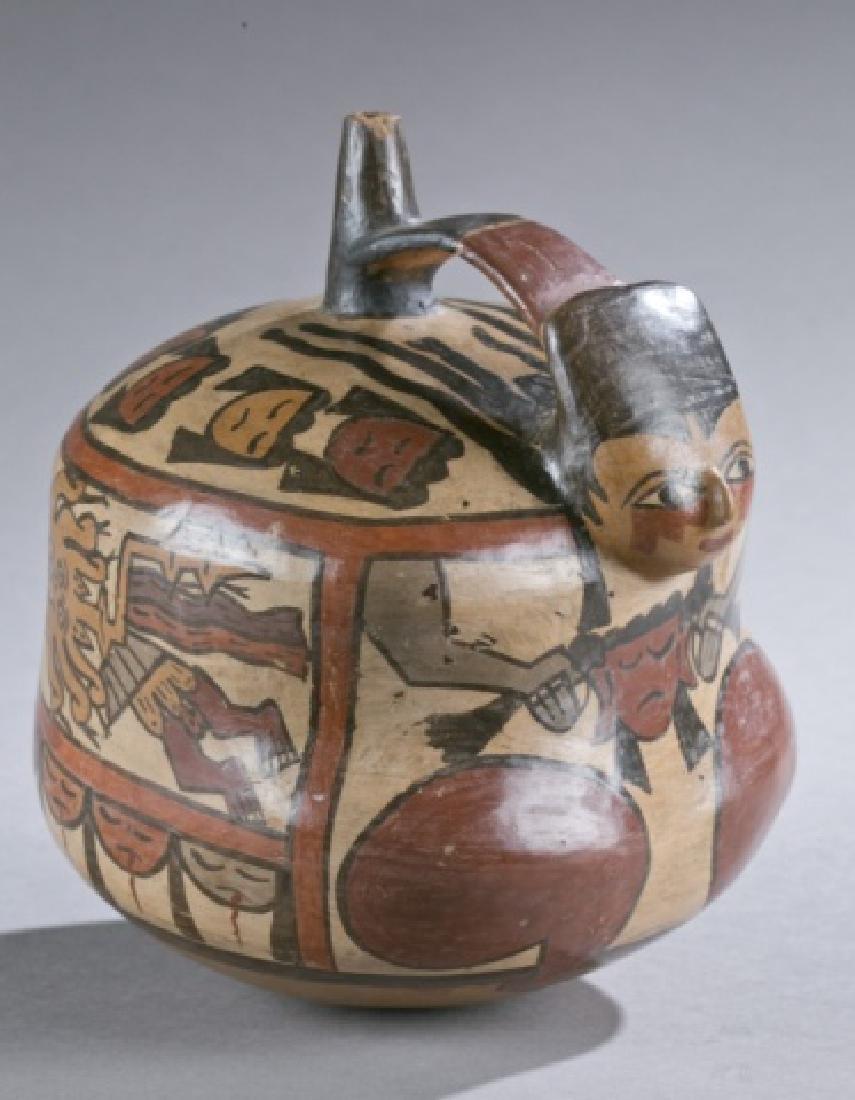 Nasca stirrup vessel with figurative form.