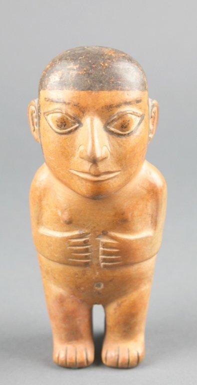 Pre-Columbian terracotta figure.