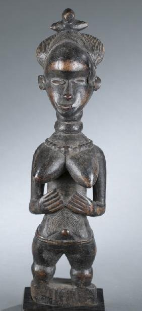 Standing Baule style female figure. 20th century.