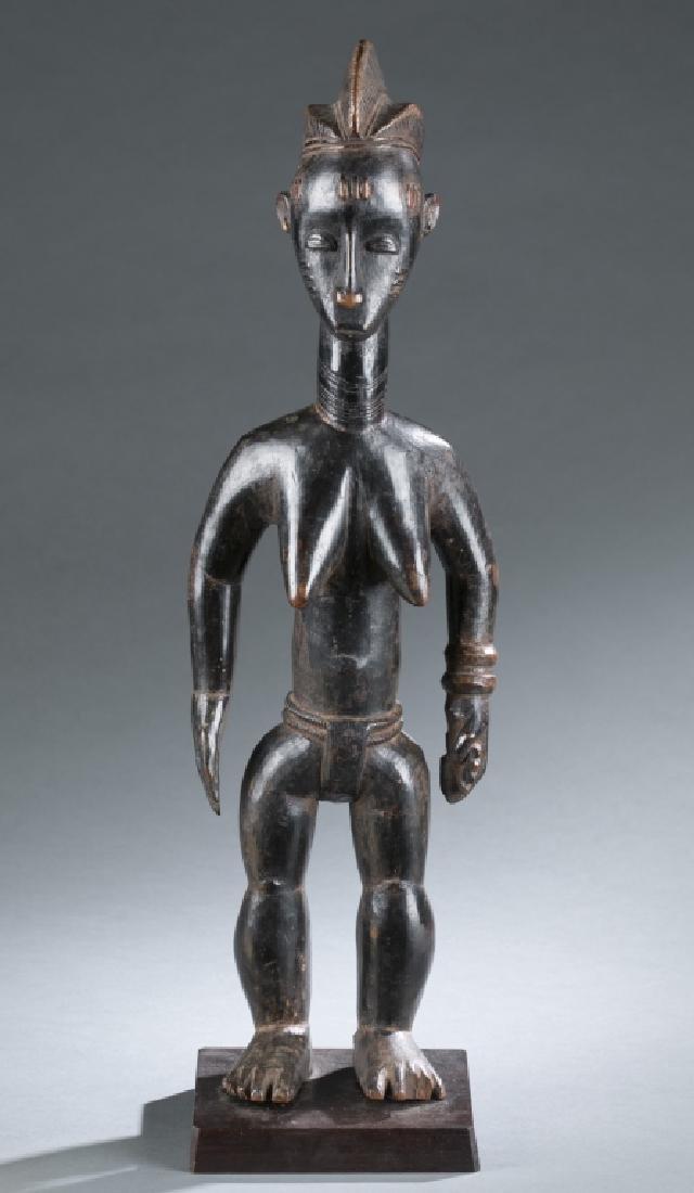 Baule female figure. 20th century.