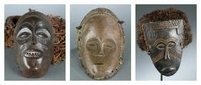3 African masks. 20th century.
