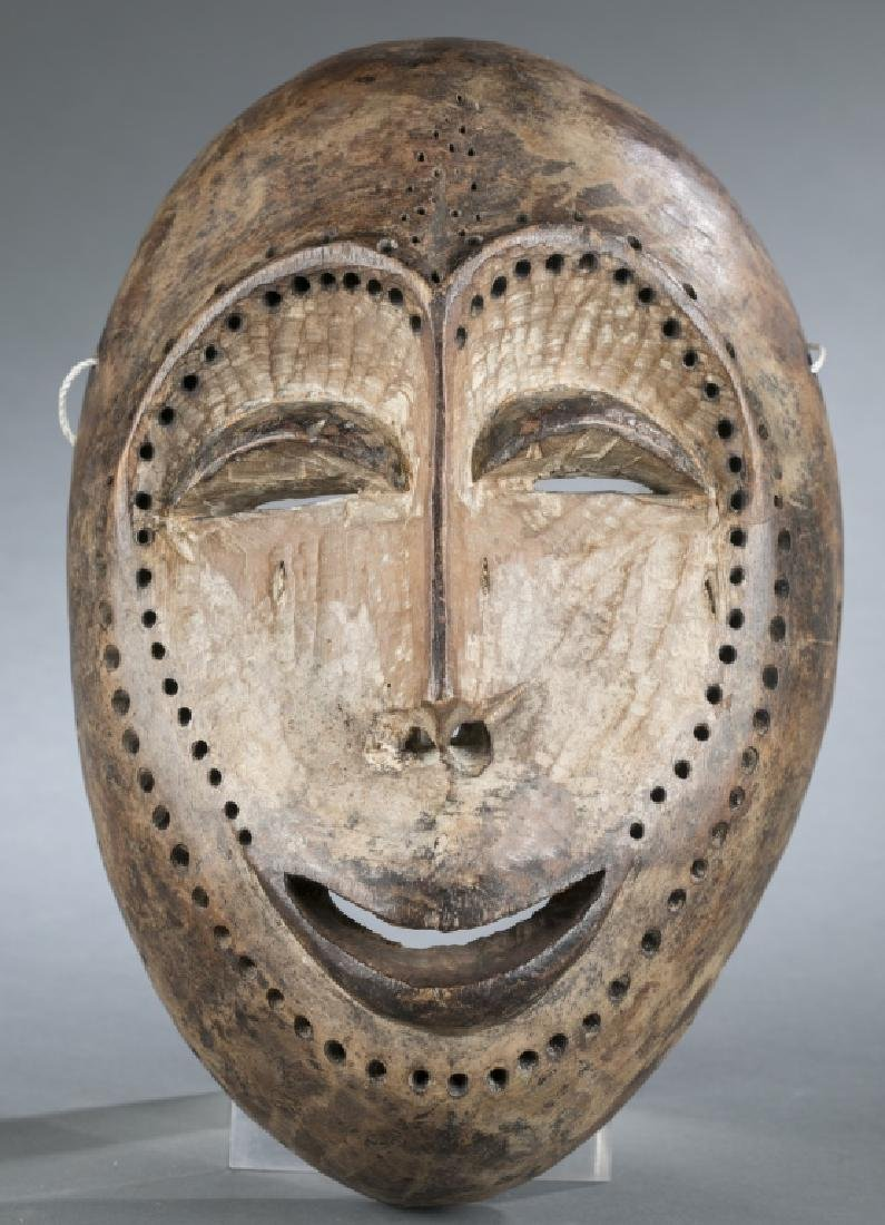 Lega style Bwami society wood mask. 20th century.