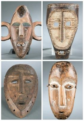 4 African style masks. 20th century.