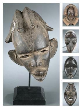 5 Dan style masks. 20th century.