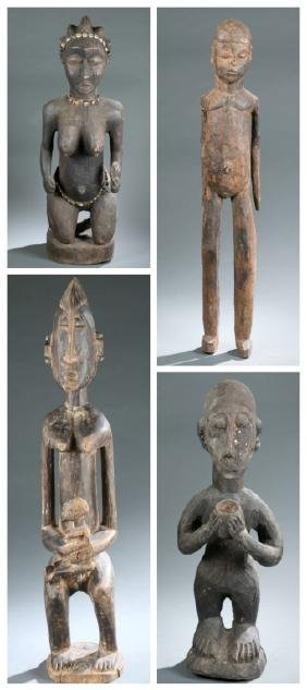 Four West African figures. 20th century.