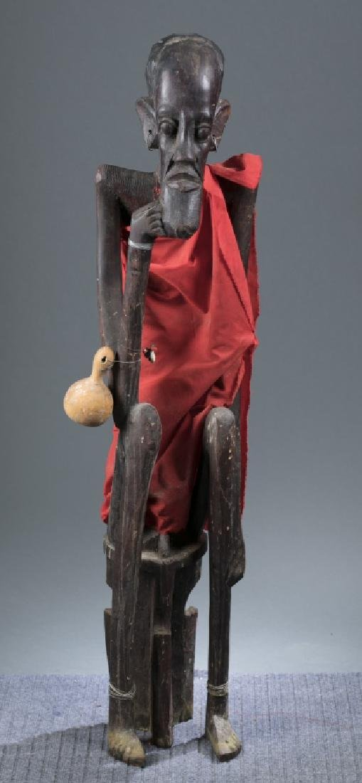 Seated African figure. 20th century.