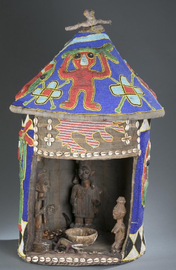 Yoruba beaded house with figures.