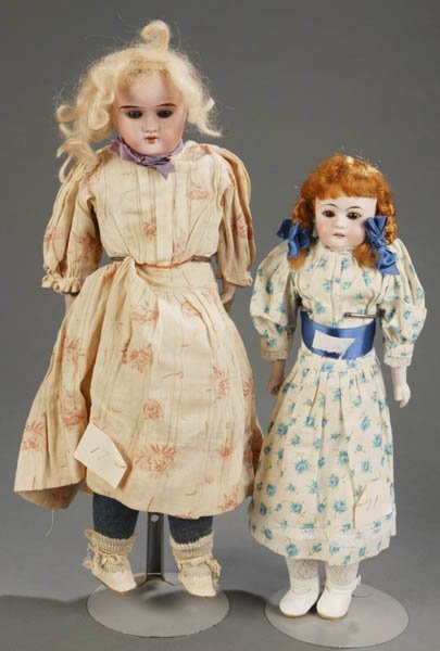 800: Pair of Straight Necked Bisque Dolls