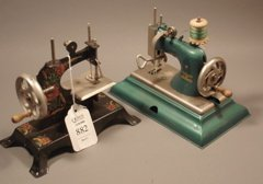882: Pair of German Casige mini toy sewing machines