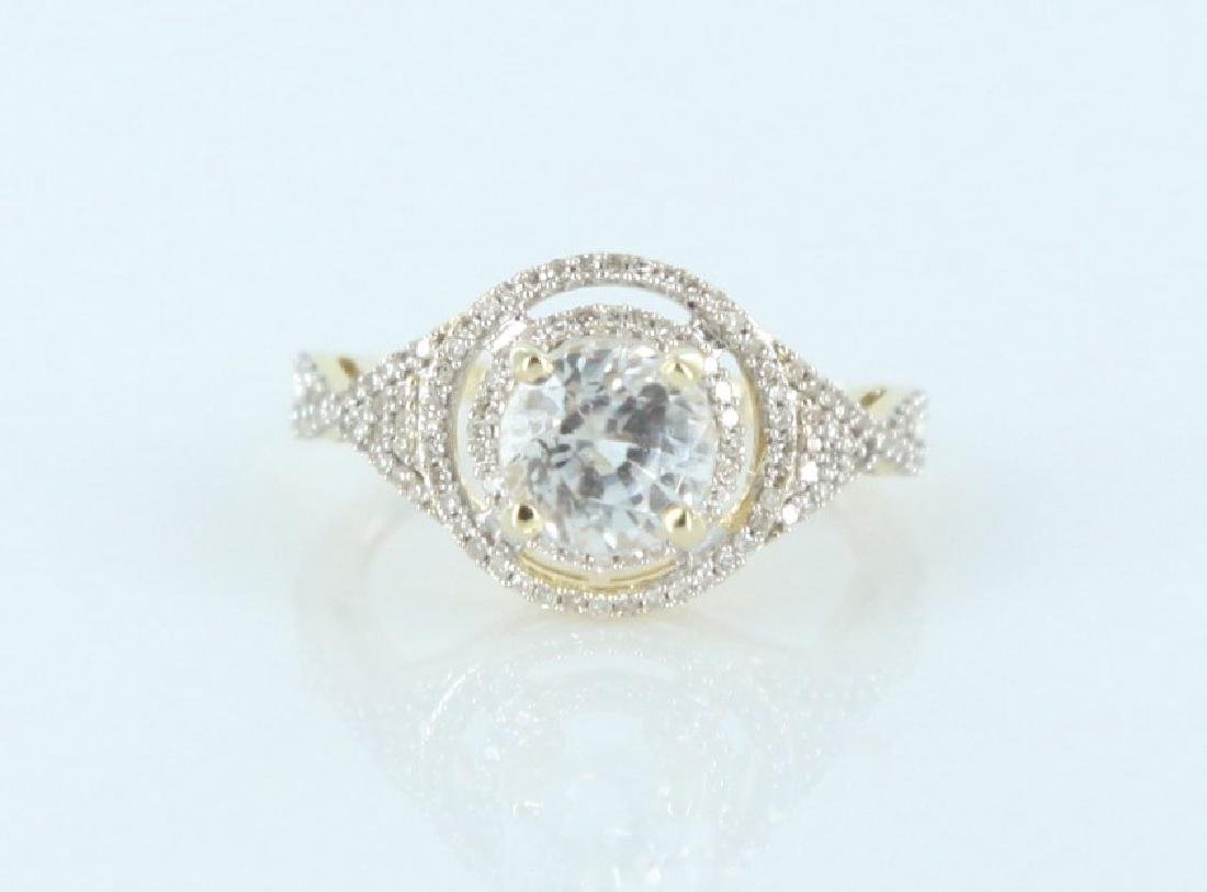 White zircon and diamond ring in 14k gold.