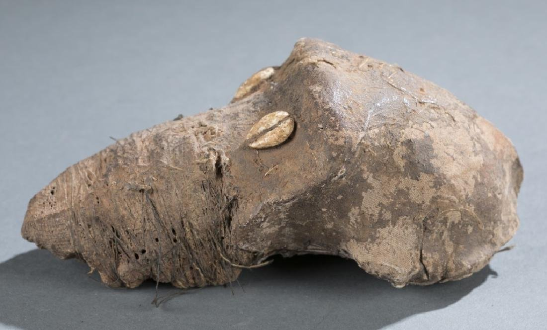 West African mud and textile monkey skull. - 2
