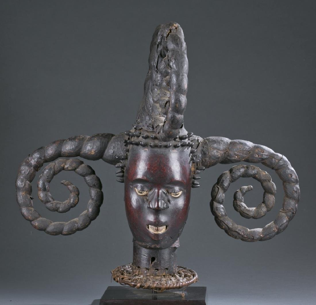 Skin covered headdress with five curled horns