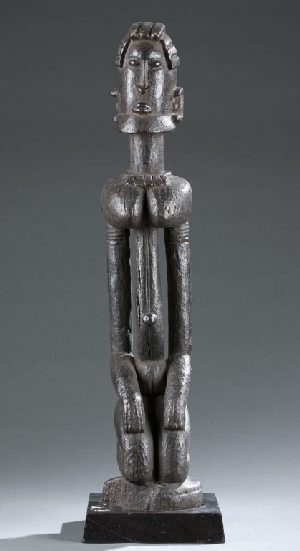 Dogon kneeling female figure. c.20th century.
