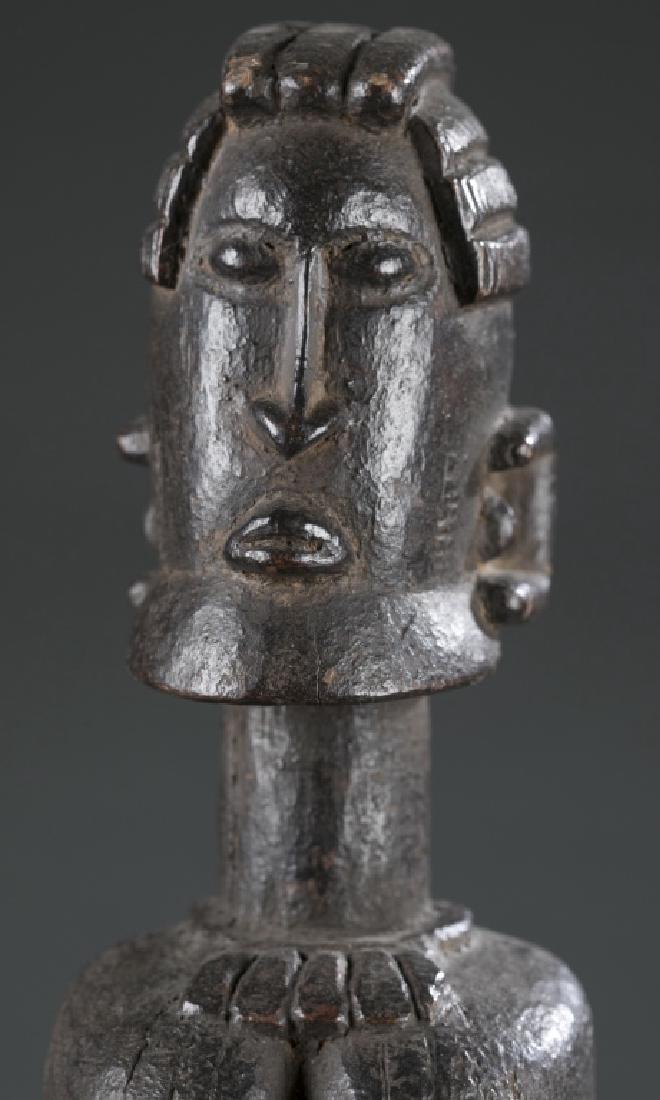 Dogon kneeling female figure. c.20th century. - 2
