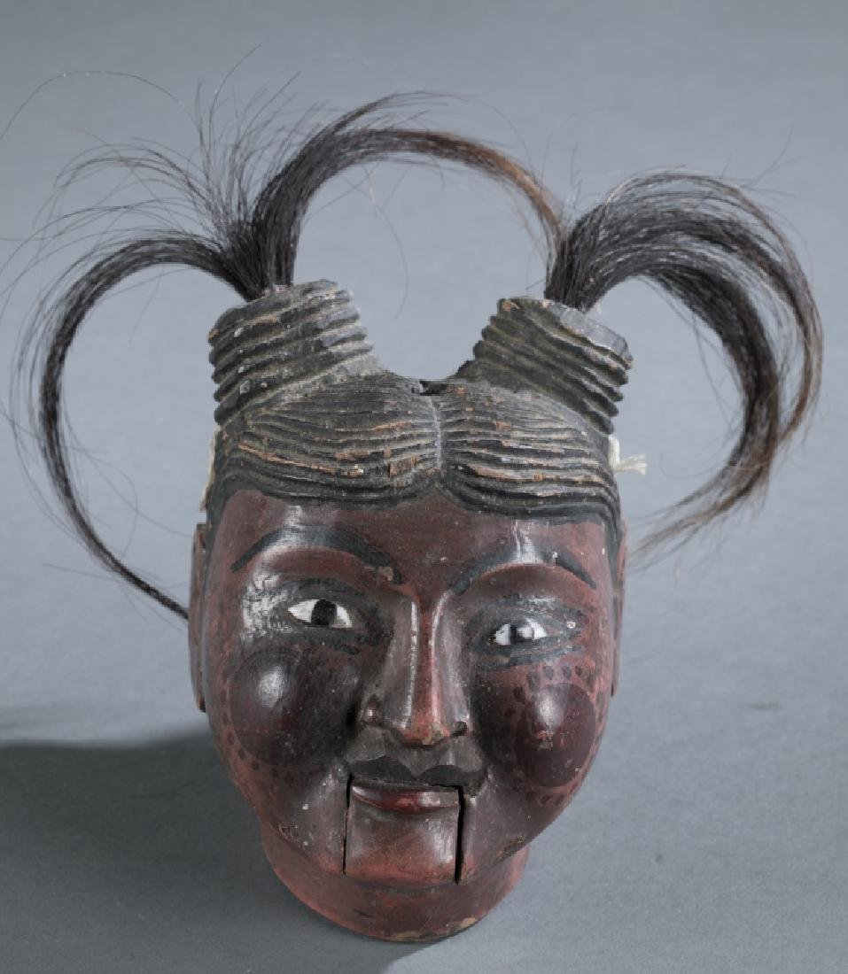 A Myanmar traditional wooden female puppet head.