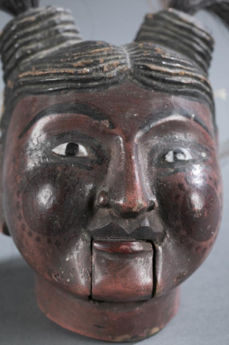 A Myanmar traditional wooden female puppet head. - 2