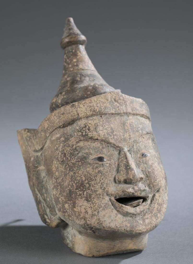 A Myanmar traditional wooden male puppet head.