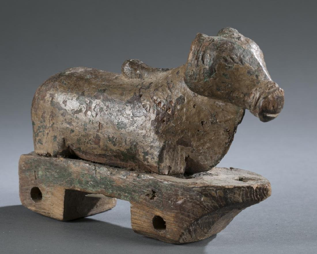 Teak wooden horse pull toy from India.