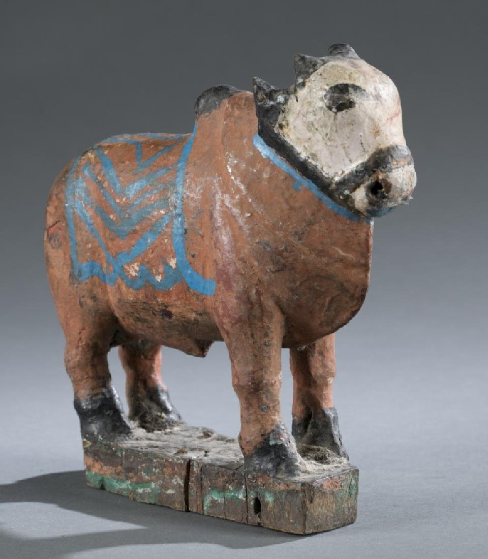 Teak wooden cow pull toy, 20th century.