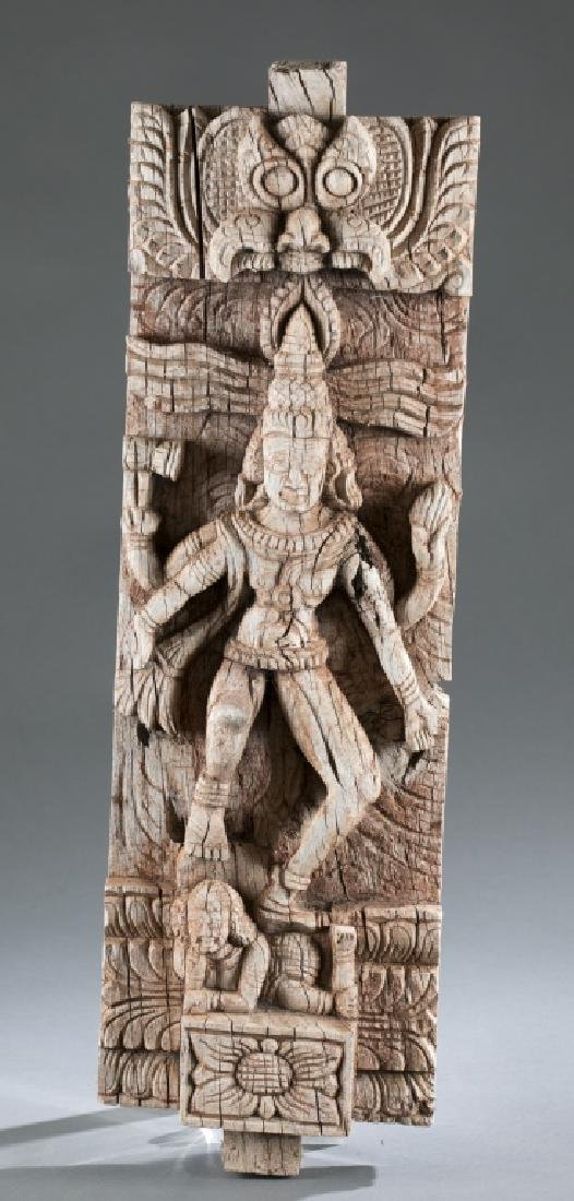Carved wooden relief sculpture