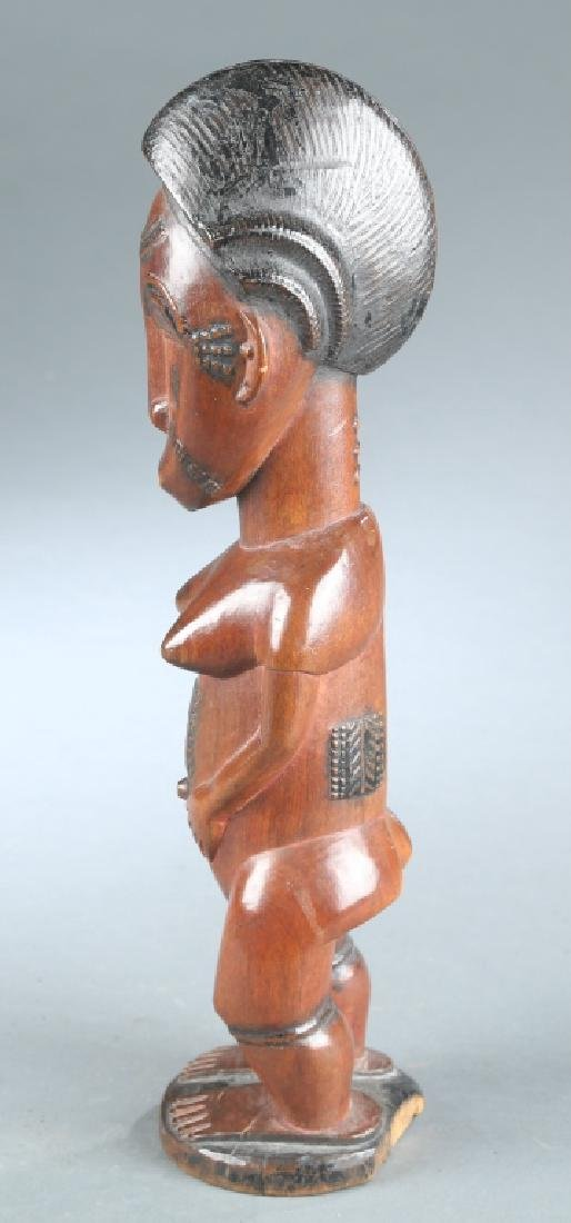 2 West African figures, 20th century. - 3