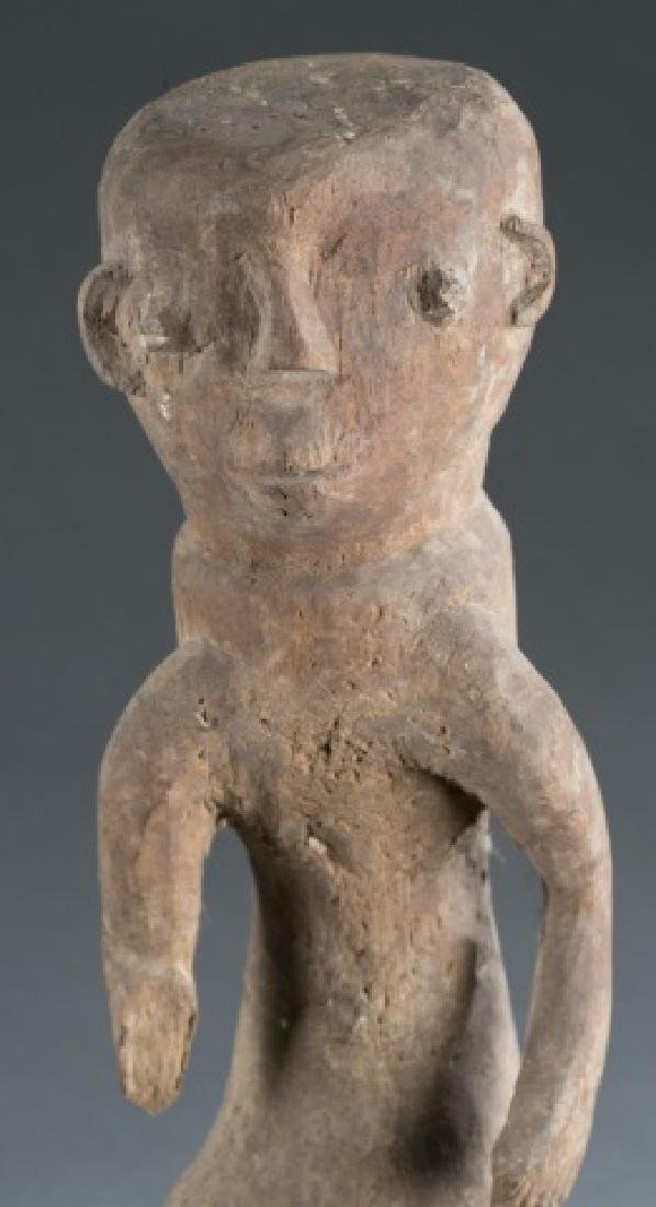 Nigerian standing male figure. 20th century. - 2